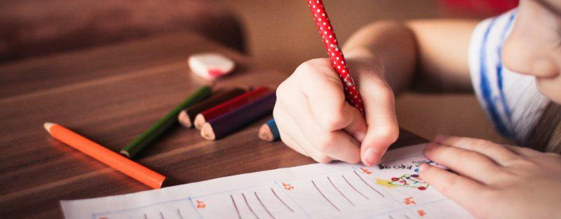 scuolasenzazaino-close-up-of-girl-writing-on-paper