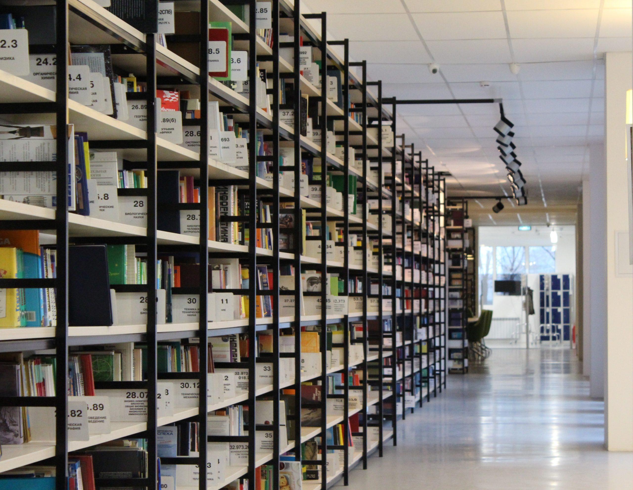stack-of-books-in-shelf